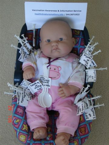 syringes stuck all over a baby doll
